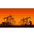 Oil pumps over sunset vector image vector image