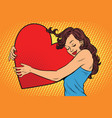 beautiful young woman hugging valentine heart vector image