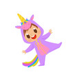 lovely baby in unicorn costume having fun vector image vector image