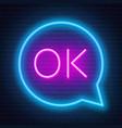neon sign ok in speech bubble frame on dark vector image vector image