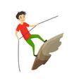 boy climbing on a rock mountain with equipment vector image vector image