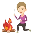 Woman roasting marshmallow over campfire vector image vector image