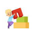 cute little boy playing with buiding toy blocks vector image