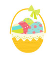 easter basket with coloful eggs and bow vector image