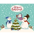 The family of snowmen dresses up a fur-tree vector image vector image