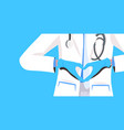doctor wearing coat and gloves doing heart symbol vector image