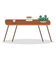 wooden table with coffee cup plant in coffeehouse