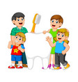 smiling parents with two kids standing vector image
