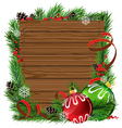 Christmas balls and pine branches on wooden board vector image vector image