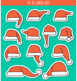 Set of 12 red doodle hats sticker Santa Claus vector image vector image