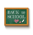 back to school on chalkboard vector image vector image