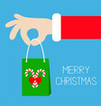 merry christmas santa claus hand holding gift vector image vector image