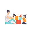 father playing toy cubes with his son dad and his vector image vector image