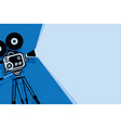 blue background with old fashioned movie camera vector image vector image