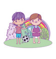 happy little boys playing soccer in the field vector image