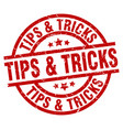 tips tricks round red grunge stamp vector image vector image