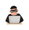 hacker in black mask using laptop for computer vector image vector image
