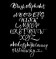Black background with white scrawling alphabet