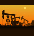 Silhouettes of oil pumps