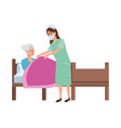nurse attending old woman in bed