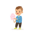 stylish preschool kid standing with sweet cotton vector image vector image