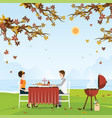 couple grilling meat and picnic table under vector image