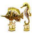 figurine of golden exotic fish and a seahorse vector image