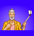 old man with selfiestick and smartphone vector image vector image