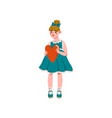 lovely girl in blue dress holding red heart happy vector image vector image