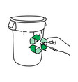 hand holding green recycle sign on trash can vector image