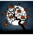 gnarled tree at night with halloween pumpkins vector image