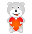 teddy bear holding red heart vector image vector image