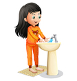 A young girl washing her hands vector image vector image