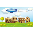An airship above the neighborhood with a banner vector image vector image