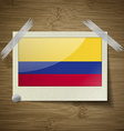 Flags Colombia at frame on wooden texture vector image vector image