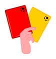 hand holding both red and yellow card vector image