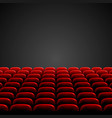 Rows of red cinema or theater seats in front of