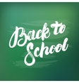 Back to school hand written lettering on green vector image