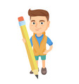 caucasian kid boy standing with a huge pencil vector image vector image