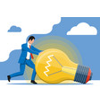 businessman pushing big light idea bulb vector image