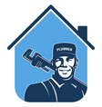 plumber with wrench and house symbol vector image vector image