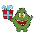 Friendly monster holding a gift box vector image vector image