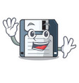waving floppy disk isolated with a mascot vector image vector image