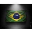 waving flag brazil on a dark wall vector image vector image