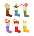 christmas stockings socks with treat gift vector image