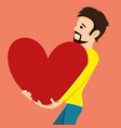 man holds a big red heart vector image vector image
