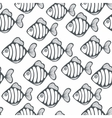 Seamless pattern with black and white fishes vector image