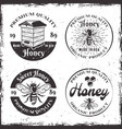 honey set of four round black badges vector image vector image