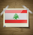 Flags Lebanon at frame on wooden texture vector image vector image
