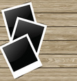 blank photos on wood background 0704 vector image vector image